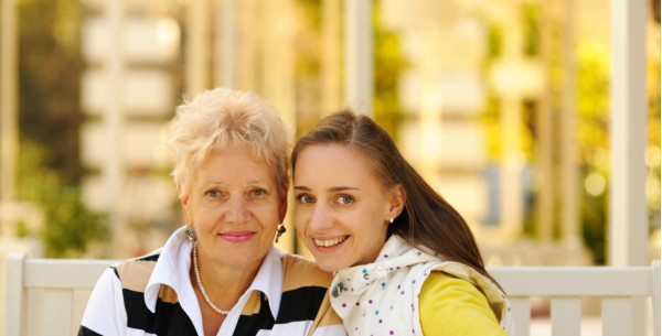 Elderly woman with her daughter smiling